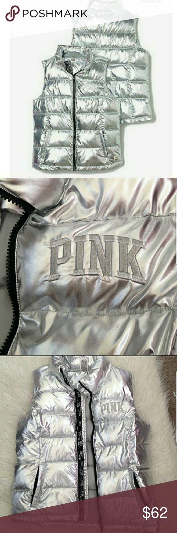PINK VICTORIA'S SECRET SILVER VEST NWOT PINK VICTORIA'S SECRET THIS SILVER VEST IS FROM THE FASHION SHOW. NWOT PINK ON FRONT AND ON BACK OF COLLAR. SIDE POCKETS. ZIP UP FRONT. A MUST HAVE PINK Victoria's Secret Jackets & Coats Vests