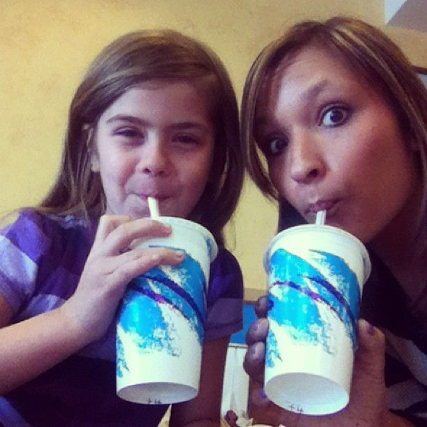 My little sister through Big Brothers Big Sisters program and me enjoying milkshakes.