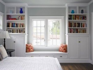 I love that this bright window seat and bookshelves as a bedroom feature (plus the cupboards provide lots of storage space for clothing). Total utility in a beautiful design.