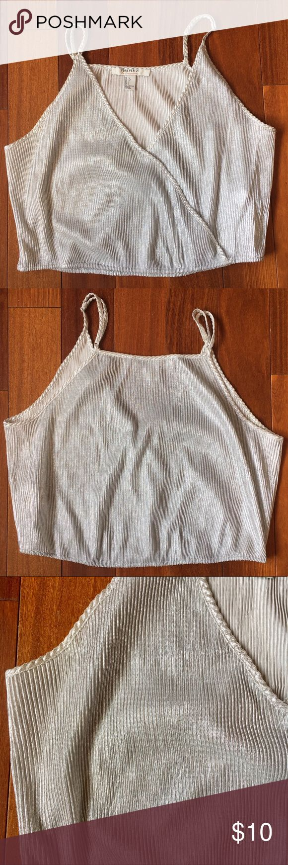 Silver cami Silver cami for a night out. Cropped and cinched at the waist. Adjustable straps. Worn once. Forever 21 Tops Camisoles