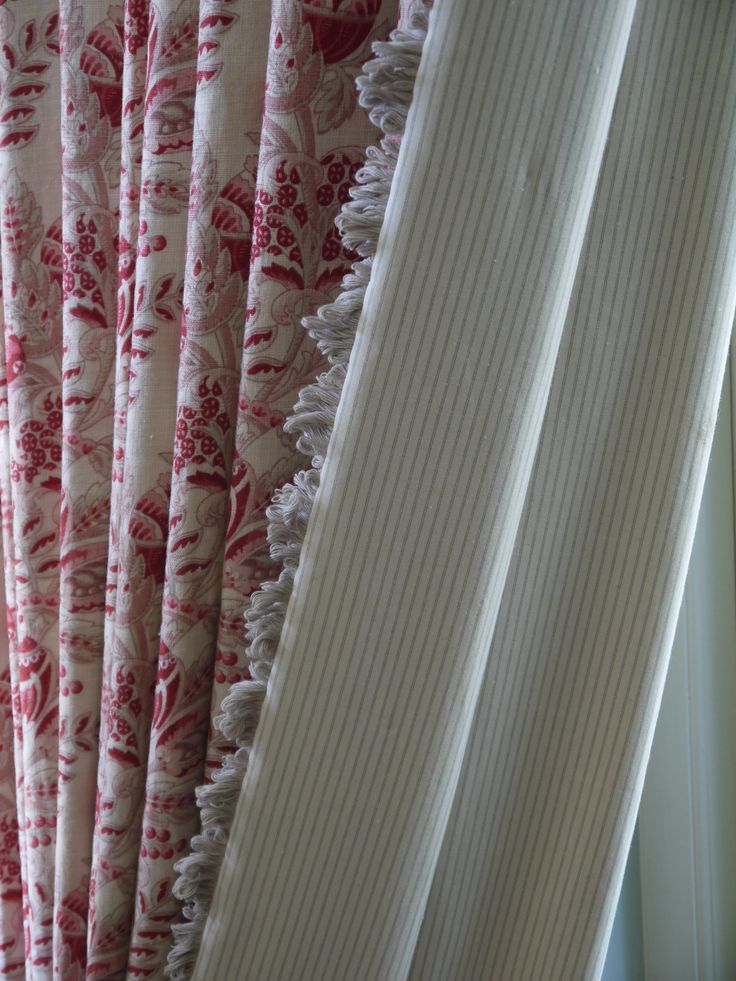 """Interlined door curtain hand made by Victoria Clark Interiors in Kate Forman """"Beatrice"""" with a fan edge trim and Ian Mankin ticking lining."""