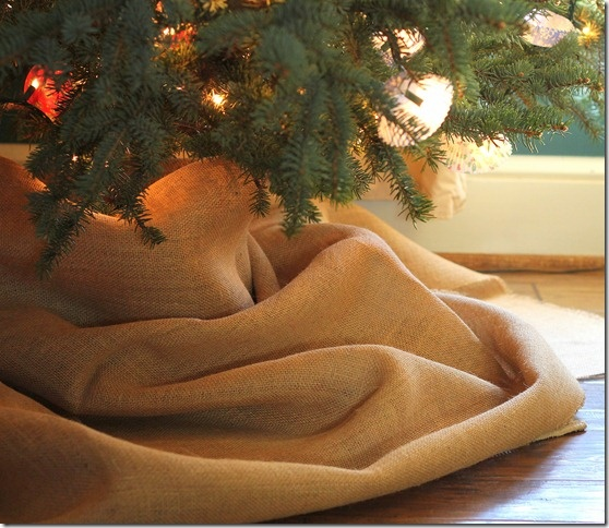 Burlap tree skirt - the easiest tree skirt - just throw it around the base of the tree. :)
