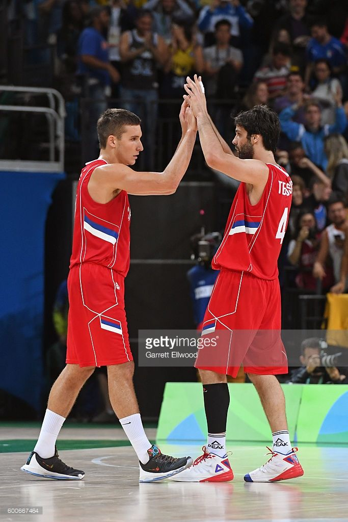Bogdan Bogdanovic #7 of Serbia shakes hands with Milos Teodosic #4 of Serbia during the game against the USA Basketball Men's National Team on Day 7 of the Rio 2016 Olympic Games at Carioca Arena 1 on August 12, 2016 in Rio de Janeiro, Brazil.