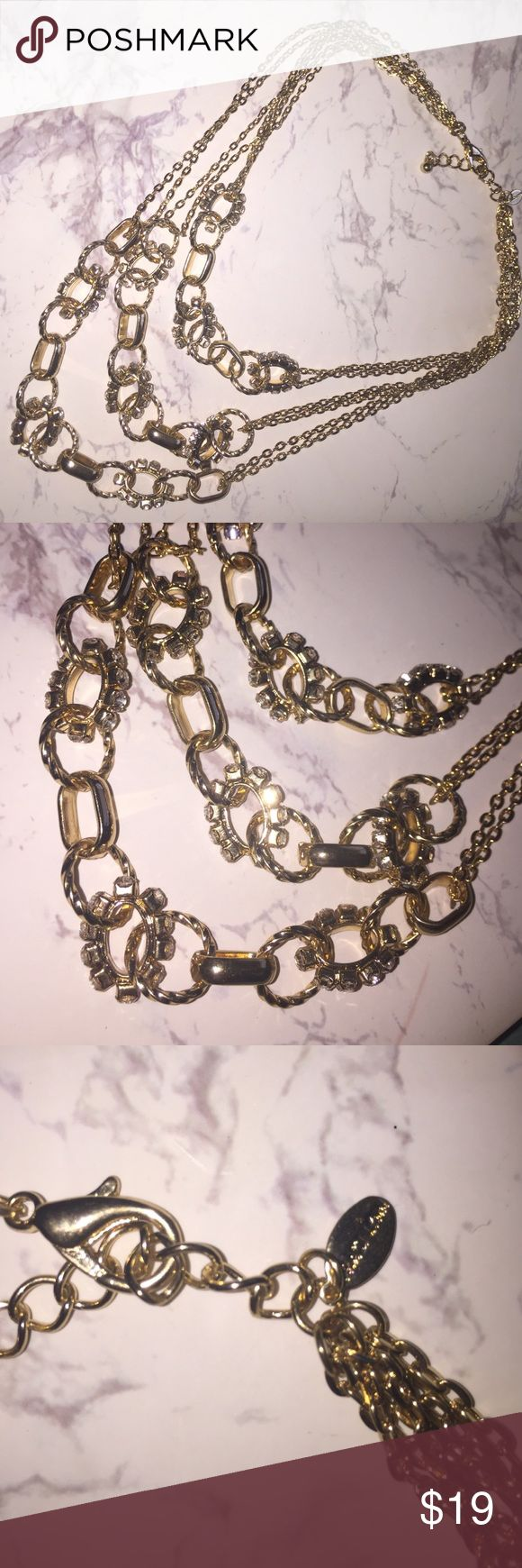 Traci Lynn Gold Necklace Multi strand gold necklace with rhinestones. Never been worn Traci Lynn Jewelry Necklaces
