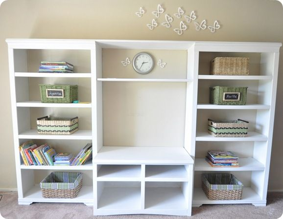 two bookcases paired with a TV stand to make one beautiful large media center for $60!!!