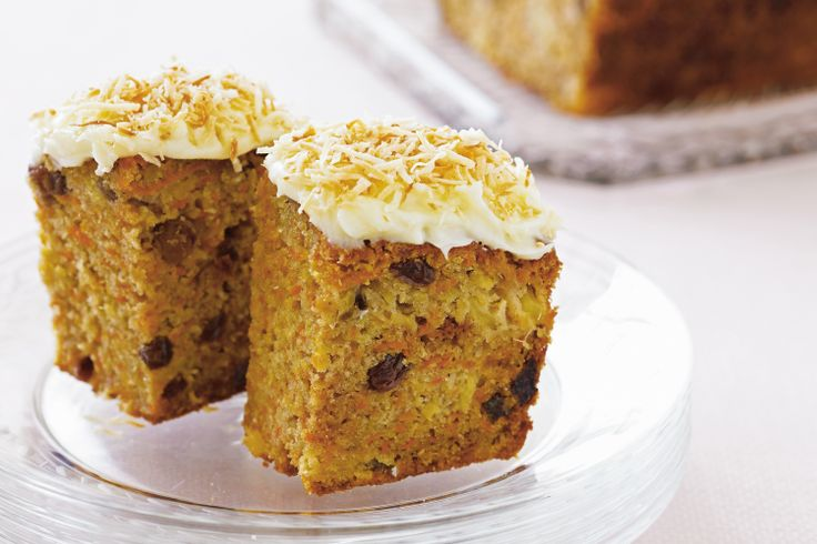 This irresistibly moist carrot cake is given the final touch of a luscious cream cheese frosting with a hint of orange.