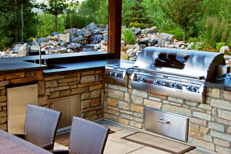 Dream of cooking outdoors in your spectacular outdoor kitchen? You home will be the spot for outdoor dinner parties during the summer months. #outdoorkitchen #landscaping #calgary #backyard #design