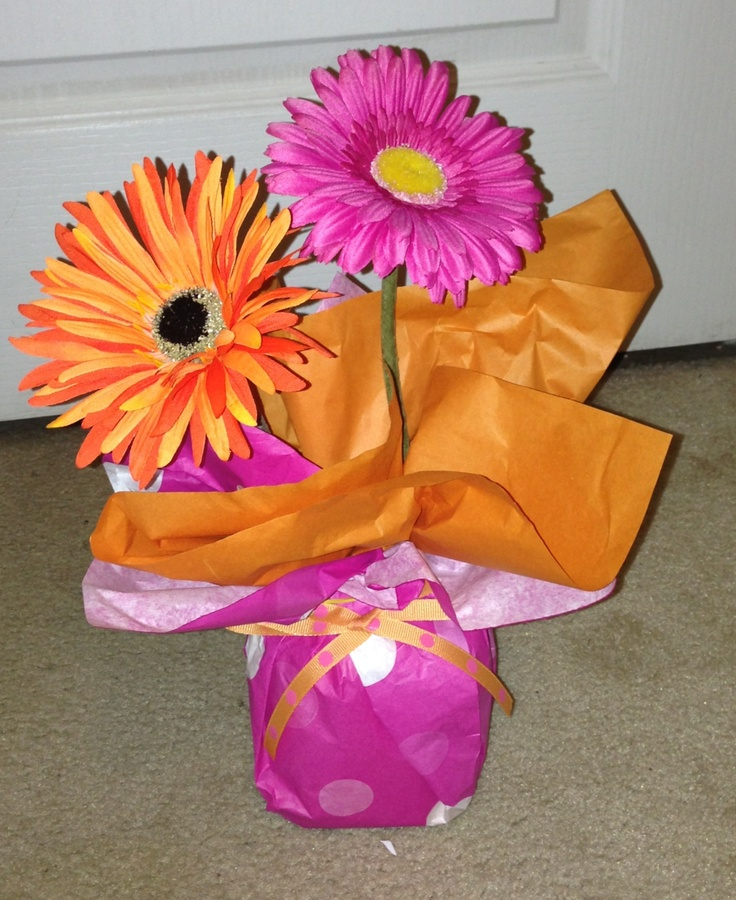 Orange and pink daisy center pieces for a Dora birthday party:)
