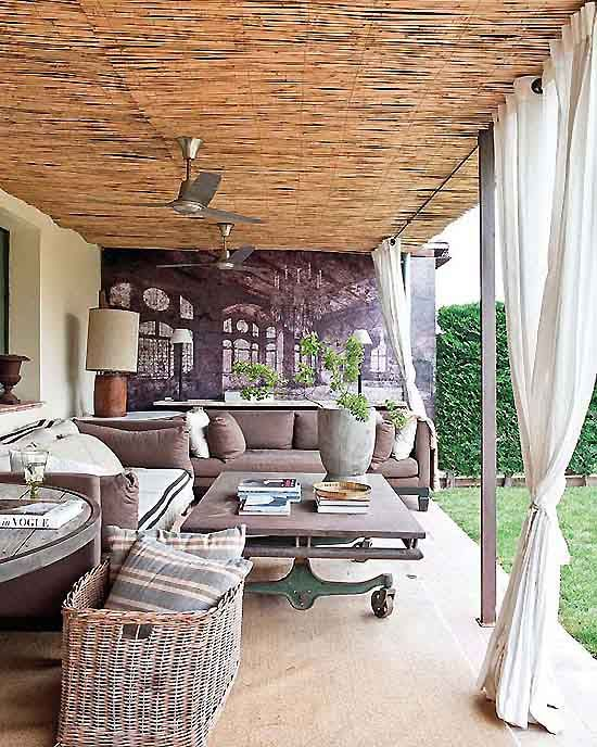 outdoor coffee table - love the casters - love this entire look. similar size to our back porch. Love the reed on the ceiling - maybe a great way to cover up our less than attractive metal patio cover. :)