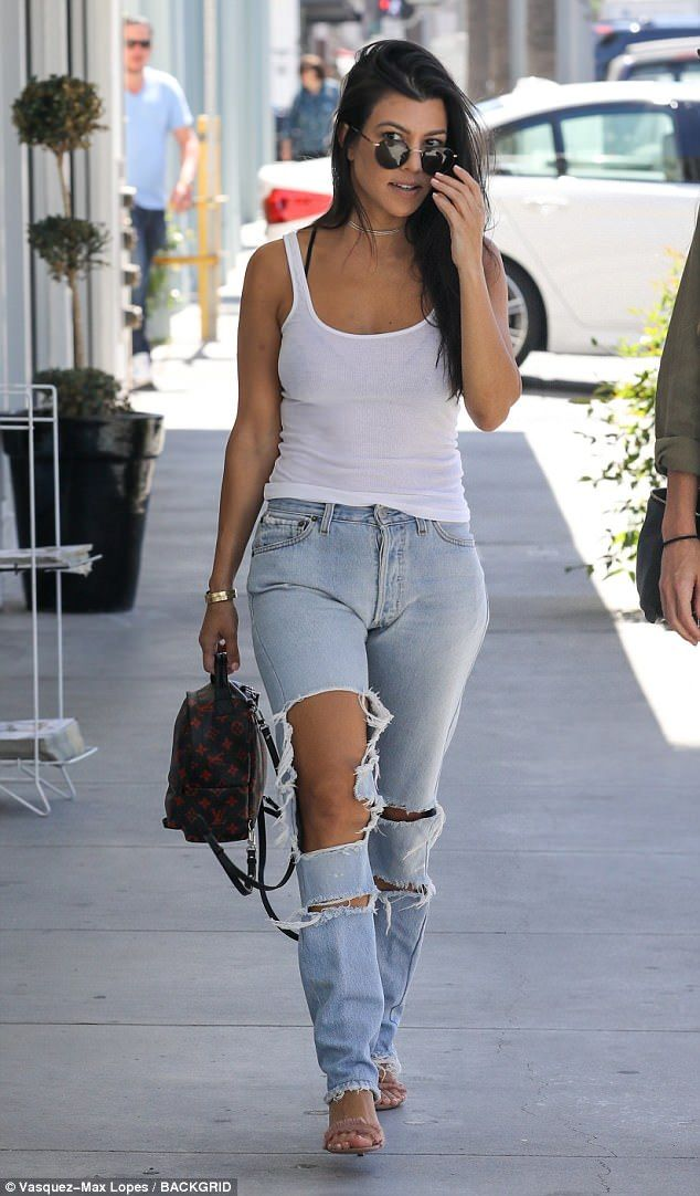 Ripped and tanned: Kourtney Kardashian wore destroyed denim to visit the skin doctor in Beverly Hills