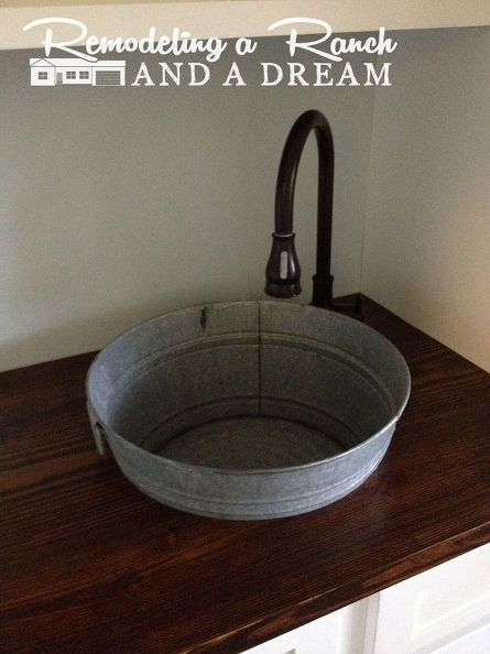 q making a galvanized tub into a sink, bathroom ideas, diy, home decor, plumbing, rustic furniture