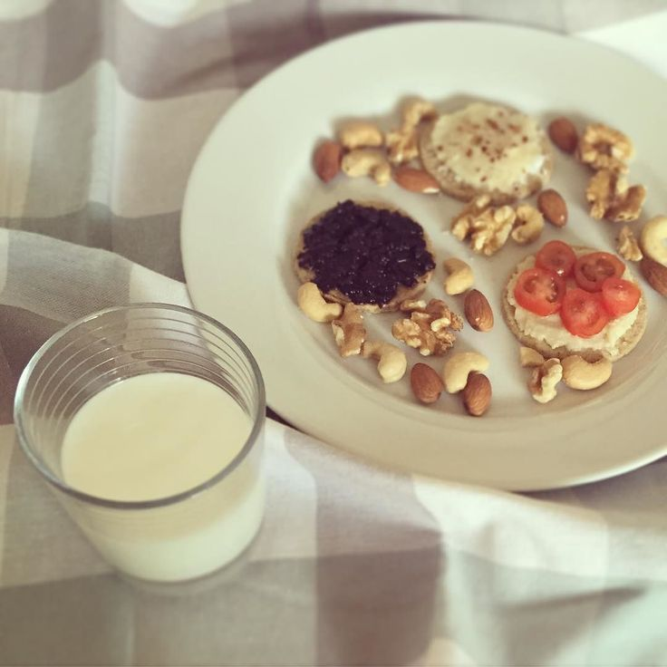 Really groggy and really hungry but I decided to have a few #superfood snacks to try regenerate my body: Glass of goats #kefir 3 #glutenfreeoats crackers by Nairns. Toppings: Black olive paste: delicious! I blended black olives a bay leaf and extra virgin olive oil into a paste a few days ago. I buy olives from ethnic/ continental shops nearby as they have better quality stuff for cheaper. This paste is really delicious and a welcome change from nut butters. Coconut butter and macadamia nut…