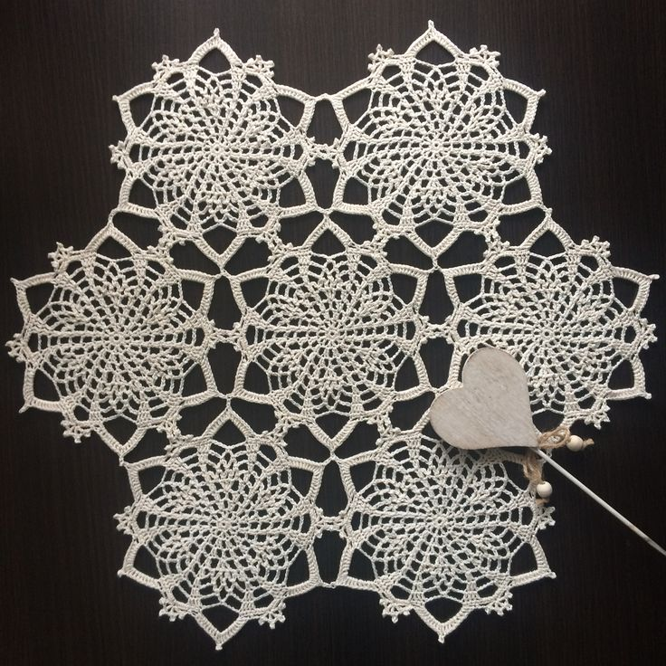 Handmade crochet doily with floral motif and natural beige color
