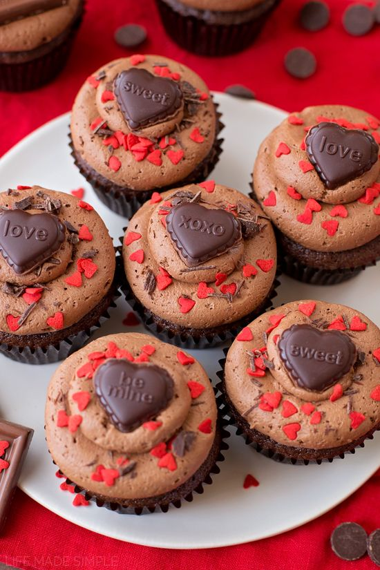 Rich, moist chocolate sweetheart cupcakes topped with a thick cocoa buttercream. Perfectly decorated for Valentine's Day! #GhirardelliVday #CG