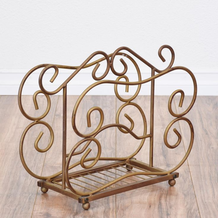 This magazine rack is featured in a durable bent metal with a shiny bronze finish. This book holder is in great conduit with curved swirl details, 2 slots for magazines and a handle top. Unique magazine rack perfect for holding knitting supplies!  #eclectic #storage #magazinerack #sandiegovintage #vintagefurniture