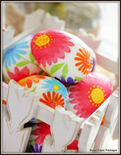 Paper napkins and Mod Podge give bright colored Easter eggs personality. From brownpaperpackagesep.blogspot.ca