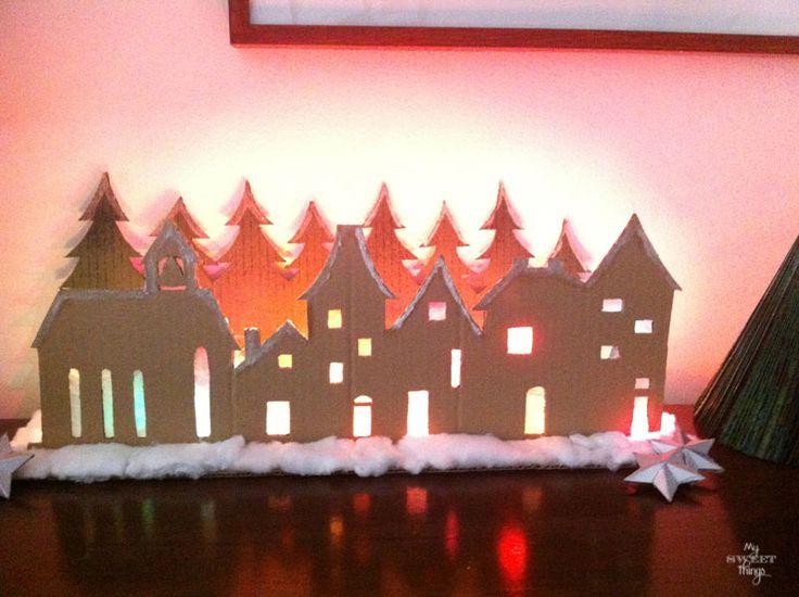 Cardboard Village    |    Cardboard Village with string lights at night     |     Via www.sweethings.net