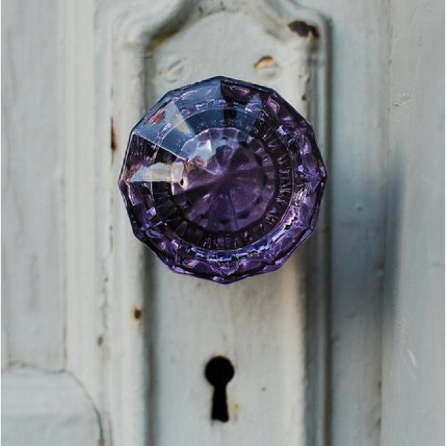 Purple diamond door handle on a white vintage door