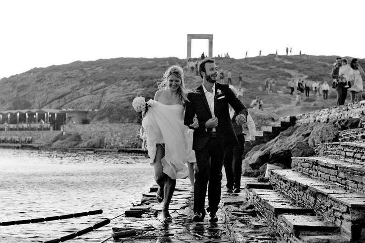 Organise your destination wedding in Naxos Island. Fantastic wedding reception and happy couple with view of the Portara in Naxos, island, Greece.