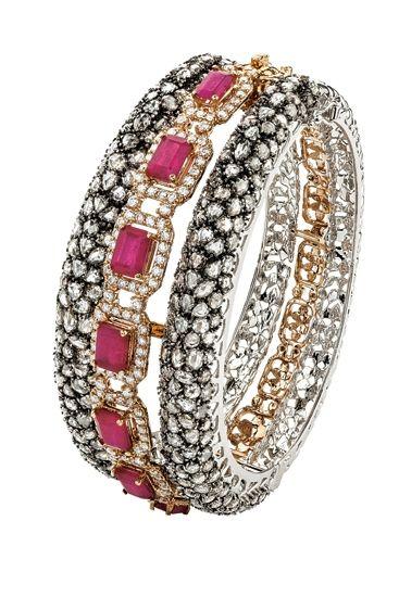 Round diamonds, rubies, rose-cut diamonds in 18K rose & white gold bracelet by Khanna Jewellers