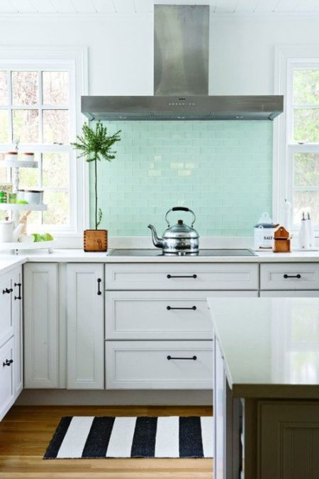 a stunning  turquoise backsplash behind the stove.