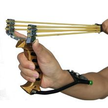 Poderosa Catapulta Banda de Goma Tirachinas con Plegable Muñequera de Oro Arco de Caza Al Aire Libre Sling Shot(China)