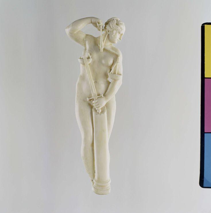 Anonymous | Justitia, Anonymous, c. 1600 - c. 1625 | Vlak reliëf met naakte vrouw, staand achter een gebroken zuil; haar linker hand rustend op de zuil met een opgeheven zwaard, de rechter arm opgeheven tot naast het afgewende hoofd en dragende een weegschaal. De achterzijde van het reliëf is vlak met een afschuining an de voet. In het lichaam zitten twee gaten van een oude bevestiging aan de achterzijde.