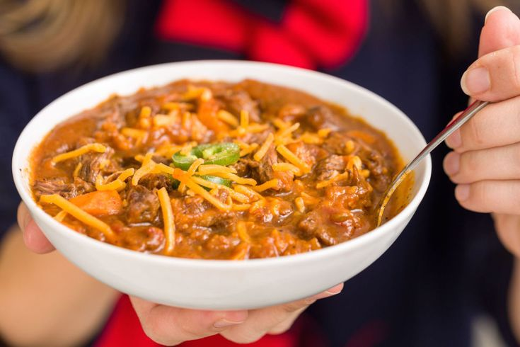 You've gotta braise your chili in beer for Super Bowl Sunday. Get the recipe from Delish.