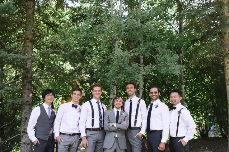 Groom and mismatched groomsmen attire in grey, black and brown