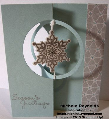 Handmade Christmas card.  Flip card with spinning image using Stampin' Up! Festive Flurry Set and Circle Card Thinlits.