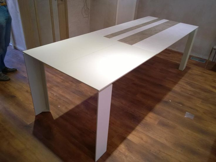 Fully extended TAVOLE ceramic top dining table. Top can be done in one surface of ceramic or glass, and also in striped ceramic or striped glass. Other sizes and finishes available in our website. Delivered to our client in Surrey.