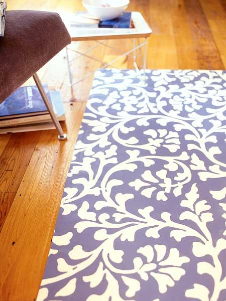 Simple to make and surprisingly durable, painted canvas used as a floor mat adds graphic punch to a room. One starting point: Choosing printed designs and photocopy them. (Photo: E. Spencer Toy)