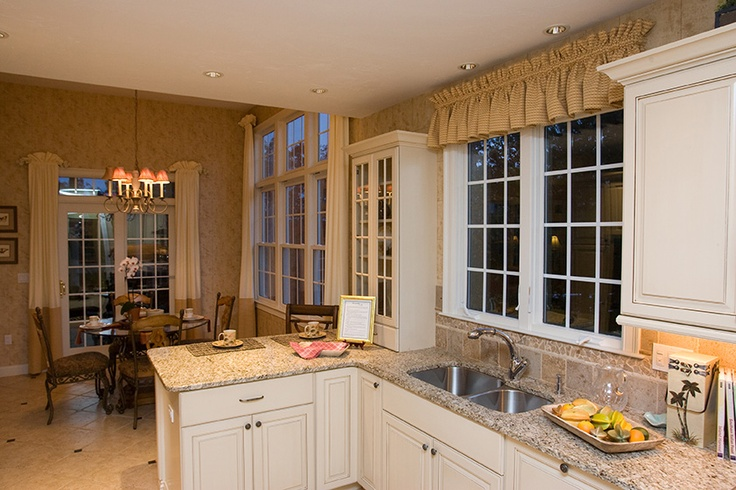 I love how the window grilles and cabinet doors coordinate perfectly!  Windsor Legend cellular PVC windows and doors. www.windsorwindows.com