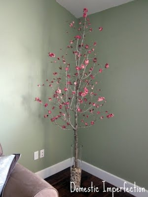 Dead tree + fake flowers  I'm soo doing this!! I love it