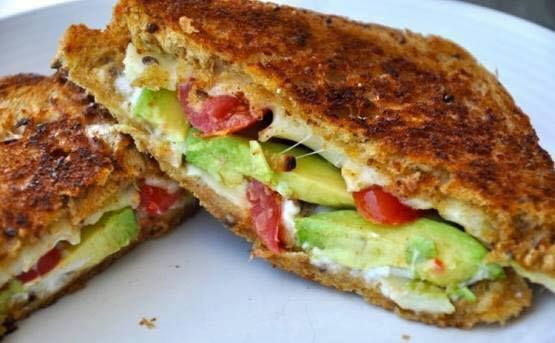 It's National Grilled Cheese day!  Avocado, Mozzarella, and Tomato Grilled Cheese Ingredients : ½ avocado (sliced)  4 slices mozzarella cheese  4 cherry tomatoes (sliced in half)  2 slices multigrain bread ( I like Ezekiel sprouted grain bread) a dab of butter Method :  Butter the outside layers of the bread. Place one slice, buttered side down in a frying pan -heated at medium heat. Layer the cheese, tomato and then the avocado.  Place the other slice of bread on top- butter up. Flip after…