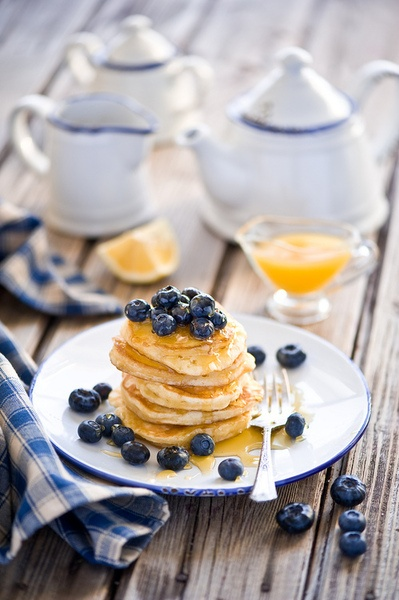 breakfast with pancakes, blueberries and honey; photography by  Anna Verdina on Flickr