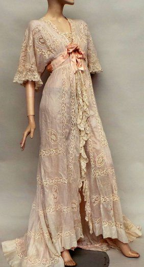 Lot:An early 1900s silk and lace negligee. A beautiful, Lot Number:529, Starting Bid:£40, Auctioneer:Busby, Auction:An early 1900s silk and lace negligee. A beautiful, Date:12:30 AM PT - Mar 17th, 2016
