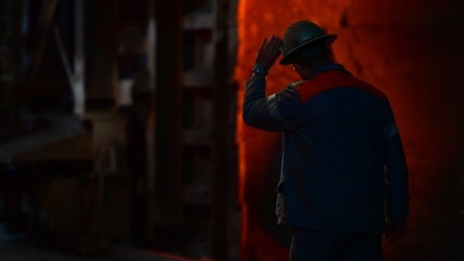 A worker at a steel factory in Germany