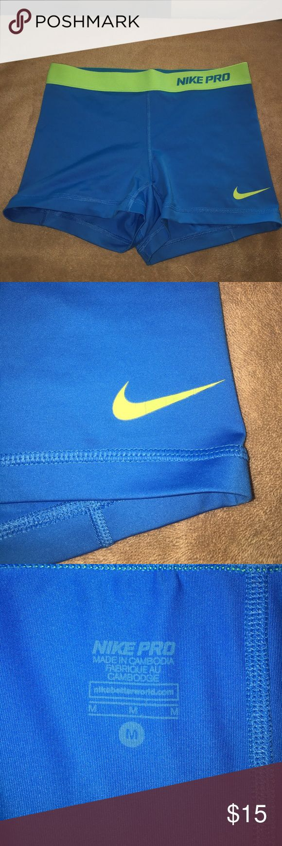 Light blue Nike pro dri-fit spandex sport shorts Great condition. Light blue shorts with neon yellow waist band. Size medium Nike Shorts