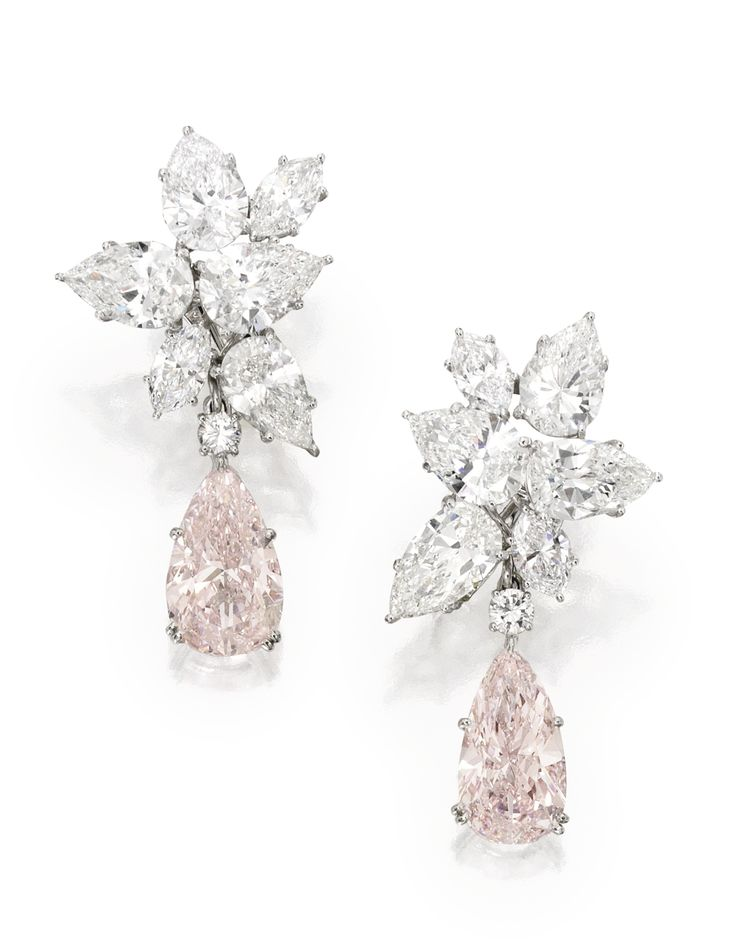 Magnificent Pair of Platinum, Fancy Pink Diamond and Diamond Pendant-Earclips Set with two pear-shaped Fancy Pink diamonds weighing 5.79 and 5.68 carats, suspended by clusters of round, pear and marquise-shaped diamonds weighing approximately 19.25 carats; pendants detachable. [Sold for 4.5 million USD]