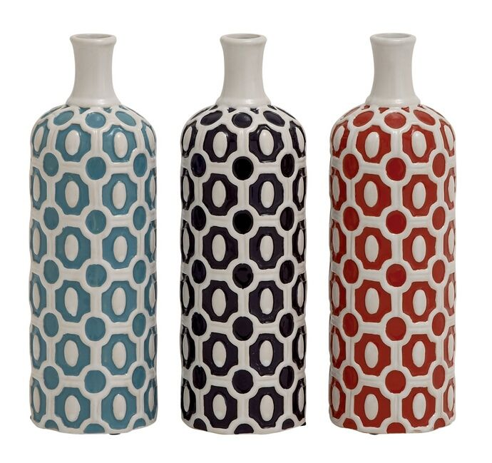 Attractive And Stylish Ceramic Vase 3 Assorted.  Give Your Home A Splash Of Elegance With These Stunning Vases. Made From Ceramic Material, These Set Of Three Vases Are Cylindrical In Shape With A Long Neck And Narrow Opening On The Top. These Vases Are Painted In Hues Of Vibrant Orange, Stunning Purple And Soothing Blue With Bold Raised Designing In White Hue. Complete With Glossy Finish, These Vases Are Sure To Make Your Home Look Spectacular. Place Them In Any Space Or Corner Of Your…