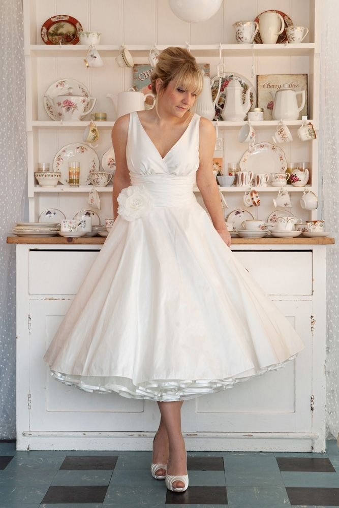"""""""Milan"""" gathered, cross-over bodice with """"Julietta"""" tea length skirt, made in ivory silk dupion, as a dress, with gathered waist panel, ivory ribbon-edged 1950s petticoat and silk rose. Design your own gown at www.app.carolinearthur.com"""