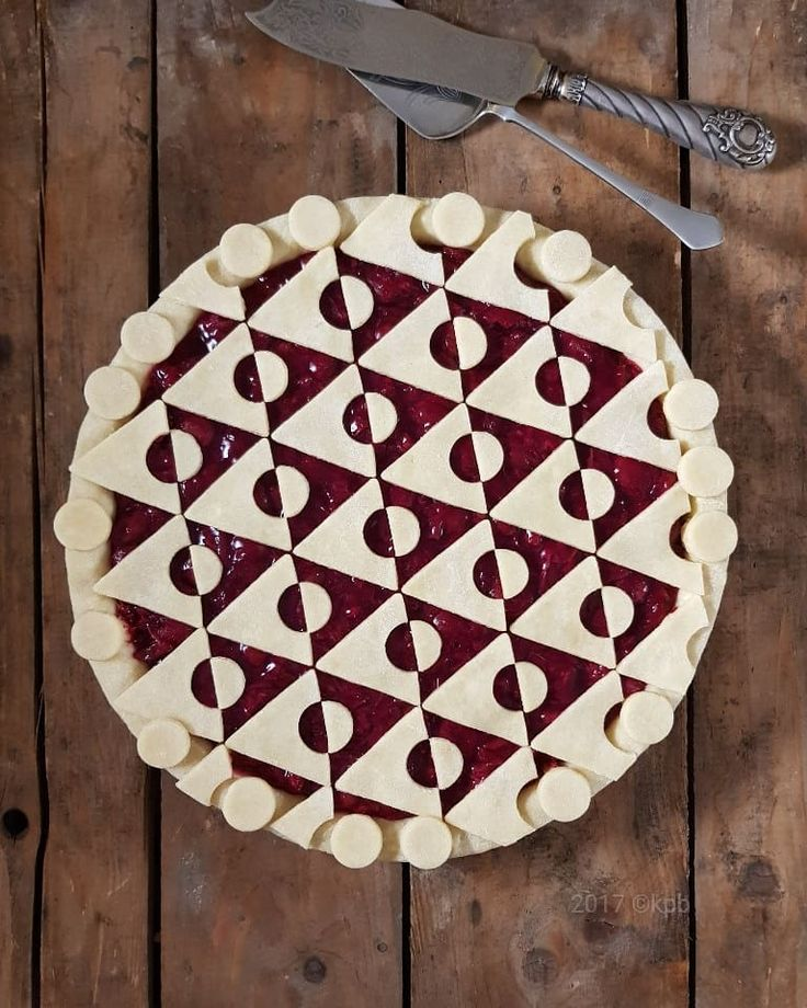 Geometric Triangle Pie with gooseberry and sour cherry filling.