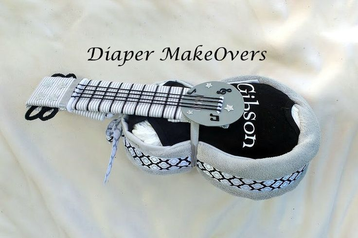 Guitar Diaper Cake - Personalized Baby Gift - Baby Name - Baby Shower Gift - Shower Decor - Gender Neutral - Rock and Roll Theme by DiaperMakeOvers on Etsy https://www.etsy.com/listing/273468170/guitar-diaper-cake-personalized-baby