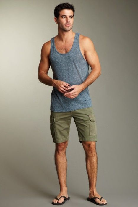 Shop this look on Lookastic:  https://lookastic.com/men/looks/grey-tank-olive-shorts-dark-brown-rubber-sandals/11004  — Grey Tank  — Olive Shorts  — Dark Brown Rubber Sandals