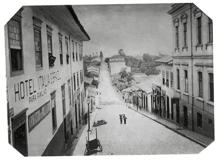 """Rua de São João, 1887. On the left, Hotel Italia Brasil """"para famílias"""" = for families.  (Militão Augusto de Azevedo)"""
