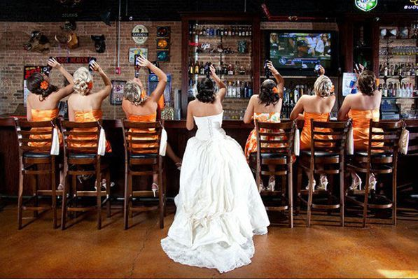 A shot with them at the bar…literally. | 42 Impossibly Fun Wedding Photo Ideas…