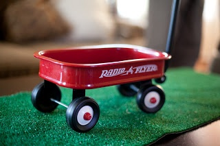 Here's Our Little Life: Fulton's little red wagon 1st birthday party - link to buy a small radio flyer wagon...astro turf at lowes