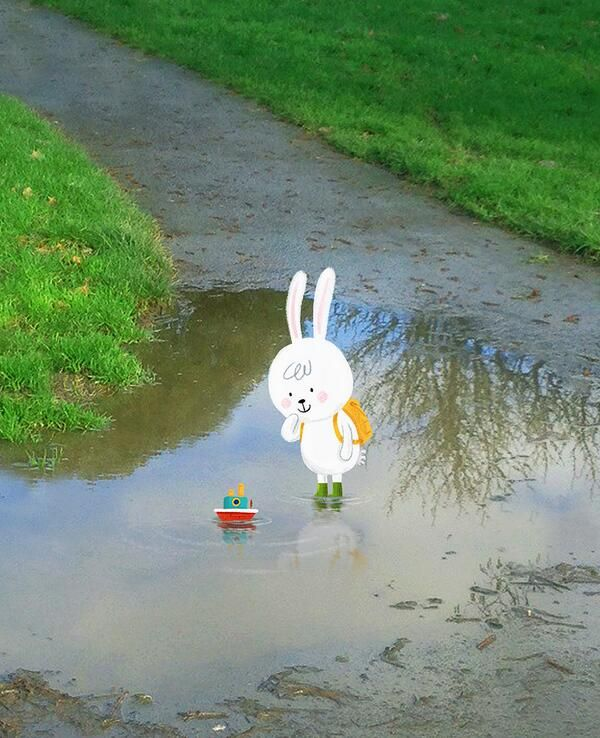 Little Rabbit playing in a muddy puddle, boat, by Chris Chatterton
