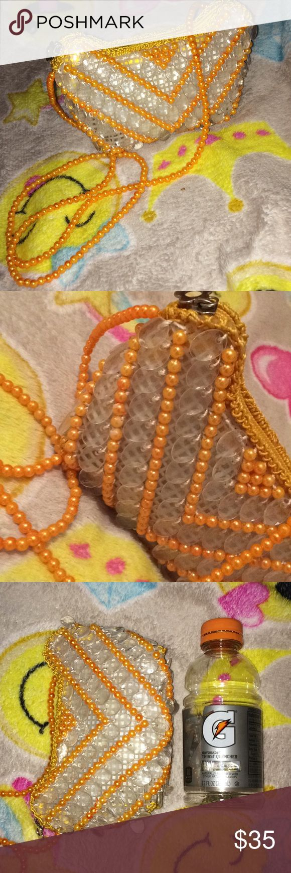 Mini handmade crossbody bag Beautiful mini handmade crossbody bag from Asia😍 Very unique and beautiful!! They were selling them in stores in Asia and the bag is handmade with the beads and everything. It's the size of a 12 oz Gatorade bottle. Colors are orange and clear and white. No Trades! Bags Crossbody Bags